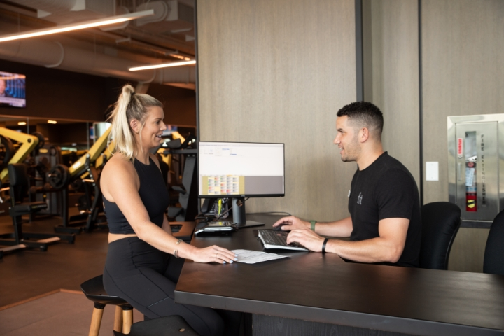 Woman signing up to be a member at fit athletic gym